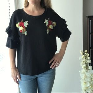 Embroidered front ruffle sleeve black top